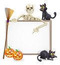 Skeleton halloween sign a with a classic character pointing down and witch s black cats broomstick and carved orange Royalty Free Stock Photos
