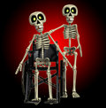 Skeleton Helping A Disabled Skeleton Stock Image