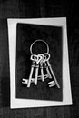Skeleton keys old grouped on black and white stone background high contrast black and white photo Royalty Free Stock Images
