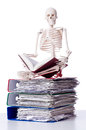 Skeleton with pile of files Royalty Free Stock Photo