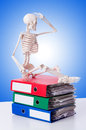 Skeleton with pile of files against gradient Royalty Free Stock Photo