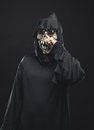 Skeleton in a robe picks his nose scary Royalty Free Stock Images