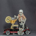 Skeleton sitting on classic car holding car keys a Royalty Free Stock Photo