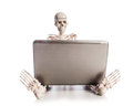 Skeleton working on the laptop Royalty Free Stock Images