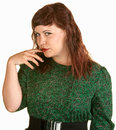 Skeptical Lady With Finger in Mouth Royalty Free Stock Images