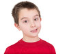 Skeptical young boy reacting in disbelief smiling ruefully and raising an eyebrow isolated on white Royalty Free Stock Images