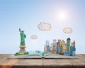 Sketch New York City and the Statue of Liberty over open book