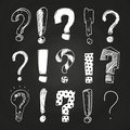 Sketch question and exclamation marks on blackboard Royalty Free Stock Photo