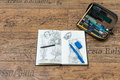 Sketchbook with beginner pencil drawings and pencil leather case full of pencils for students Royalty Free Stock Image