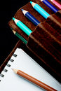 Sketchpad and colored pencils Stock Photography