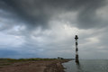 Skew lighthouse in the Baltic Sea. Stormy night on the beach. Royalty Free Stock Photo