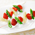 Skewers with asparagus and strawberry Royalty Free Stock Photo