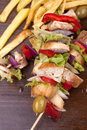 Skewers of chicken meat and vegetables Stock Images