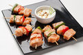 Skewers of grilled salmon Royalty Free Stock Images