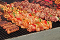 Skewers meat and vegetable on a grill Royalty Free Stock Images