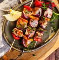 Skewers of salmon and vegetables Royalty Free Stock Photo