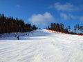 Ski hill blue sky background Royalty Free Stock Image