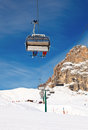 Ski lift chair with skiers at resort Royalty Free Stock Images