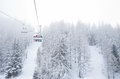 Ski lift with passengers in the gondola