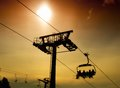 Ski lift silhouette of infrastructure with skier Royalty Free Stock Images
