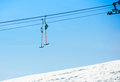 Ski lift system descending from a snowy hill Stock Image
