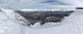 Ski lift to snowy mountain peaks. Stitched panoramic shot Royalty Free Stock Photo