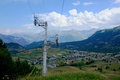 Ski lift track in the summer view of a starting a small village french alps Royalty Free Stock Photo