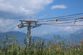 Ski lift wire tower during summer with a lot of steel wires hanging in front of a rocky mountain landscape Royalty Free Stock Photography