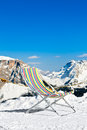 Ski lounge empty folding chair on top of a mountain against area Royalty Free Stock Image