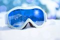 Ski mask close up and mountain reflection of snowboard with in it Royalty Free Stock Images