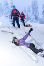 Ski patrol rescue injured skier after accident women lying in snow Royalty Free Stock Photo