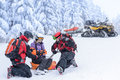Ski patrol team rescue woman broken arm women skier with Royalty Free Stock Photography