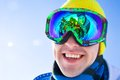 At the ski resort portrait of a young men in a mask with reflection group of friends Royalty Free Stock Photo