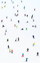 Ski resort slope background lots of skiers and snowboarders on a at sky Royalty Free Stock Photo