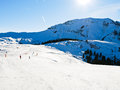 Ski run on snow slopes of mountains in sunny day Royalty Free Stock Photo