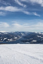 Ski slope above the lake image showing a view from top of a of a skiing resort Royalty Free Stock Images