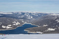 Ski slope above the lake image showing a view from top of a of a skiing resort Royalty Free Stock Photography