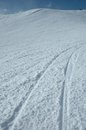 Ski tracks on slope Royalty Free Stock Photo