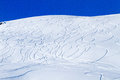 Ski tracks on snowcovered mountain side a large number of off piste snowy and sunny in the alps Stock Photography