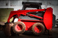 Skid loader in garage red warehouse Stock Image