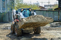 Skid loader on road construction Royalty Free Stock Photo