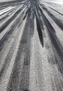 Skid marks aeroplane tires on asphalt runway Stock Images