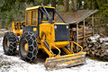 Skidder wheels equipped with snow chains Stock Photos