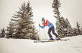 Skier in action making downhill on the mountains Stock Image