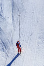 Skier ascend the slope at ski lifts Stock Images