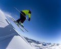 Skier in high mountains during sunny day Royalty Free Stock Photos