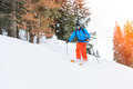 Skier jump downhill to ski mountaineering after the uphill climb Royalty Free Stock Images