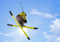 Skier jumping young man on blue sky background Stock Photo