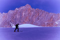 Skier man silhouette climbing mountain Royalty Free Stock Photo