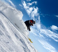Skier rush in clouds of snow powder Stock Images